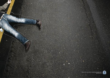 Road Safety: Headphones body Outdoor Advert by DDB Sydney