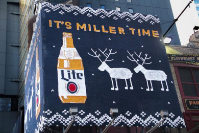 Miller Lite: Miller Lite Ugly Holiday Sweater Ooh, 2 Outdoor Advert by J. Walter Thompson New York, MMT, TBWA\Chiat\Day USA