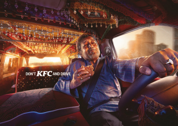 Kentucky Fried Chicken (KFC): Don't KFC and drive - Road Bite Print Ad by TBWA\RAAD Dubai